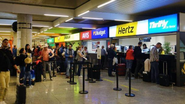People Queuing for Car Hire at Gold Coast Airport